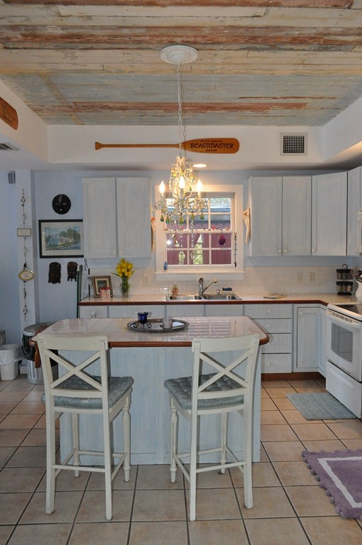 This Is A Key West Kitchen Highlighting Ceiling