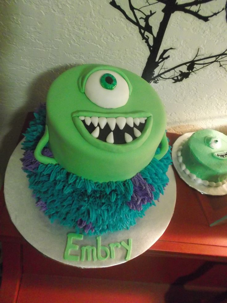 Monster's Inc. Cake Sully on the bottom tier in buttercream and Mike on the top in fondant. This was a fun cake:)