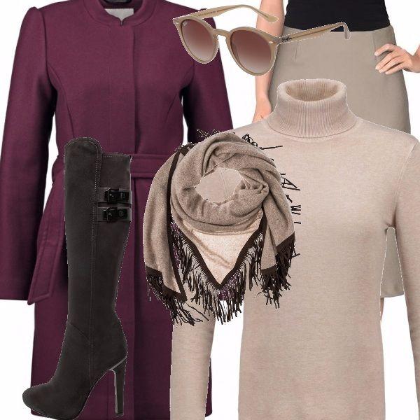 Il cappotto ad accappatoio con cintura in vita ricorda certi capi degli anni '50. La gonna di seta abbinata al maglione di lana morbida è spezzato da un bellissimo scialle di cashmere con frange. Lo stivaletto a tacco alto e l'occhiale Rayban un po' vintage, tutto rigorosamente di una bellissima tonalità neutra.