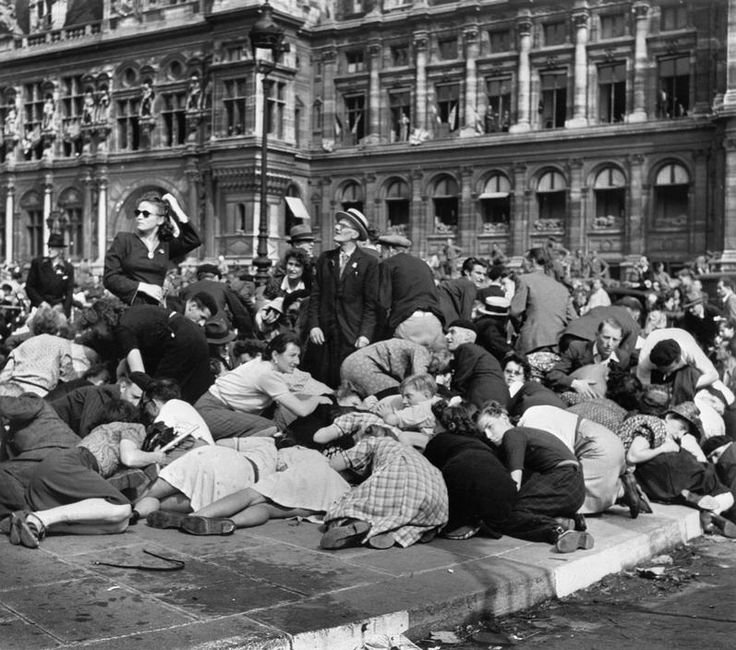 Robert Capa Paris. Place de l'Hôtel de Ville. 26th August 1944. When snipers in buildings overlooking the Place de l'Hotel de Ville opened fire on the triumphal parade, the panicked crowd fell to the pavement.