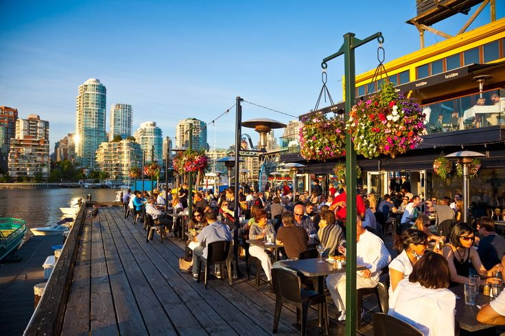 Alfresco dining on Granville Island, with Vancouver in the background. Image by Stuart Dee / The Image Bank / Getty