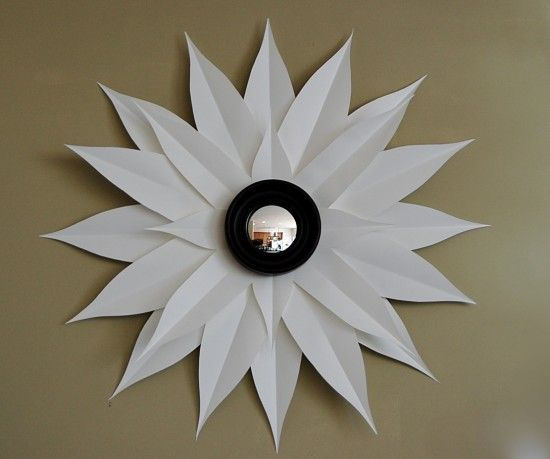 Sunburst Mirror.  Yellow paper and it could look like a Black-eyed Susan Flower (you could even add a stem).  You could use Rainbow Colors for a child's room.