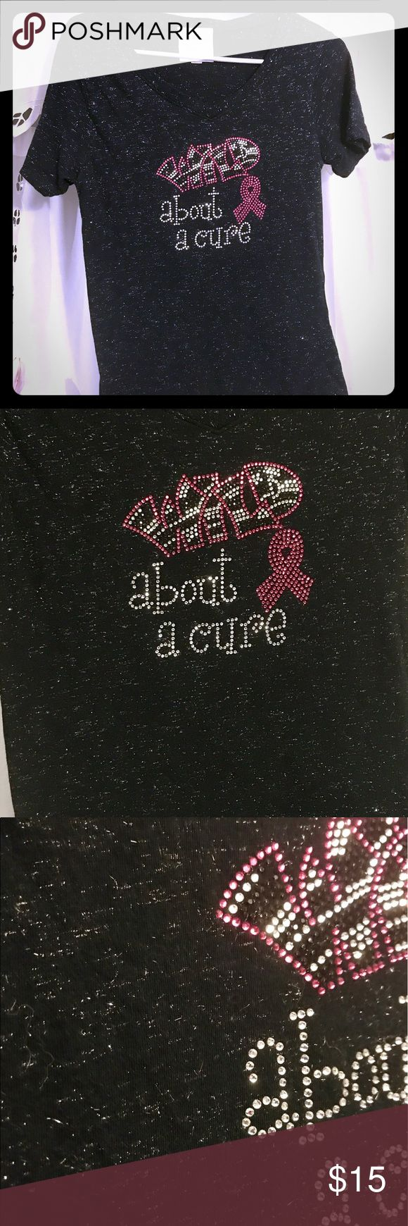 "Studded breast cancer awareness v-neck tee NWOT blinged out / bedazzled breast cancer awareness v neck women's fit medium tee, reads ""Wild about a cure"" and has silver threads in the knit! Proceeds from this sale will benefit Sisters Strong, a breast cancer support group of the Twin Cities, that I am so thankful for their support for my mother during her battle when I was thousands of miles away. She is now 4 years cancer free! It's never too soon to get checked! Save the ta tas! Tops Tees…"