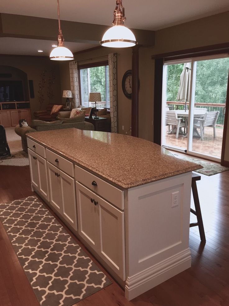 """Finished product after spraying four coats on doors in the basement and creating an """"ET like"""" plastic tent in our kitchen. Used a Wagner sprayer from Home Depot that only costs $130."""
