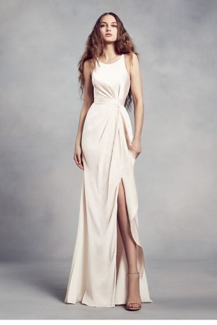 Charmeuse and chiffon come together on this White by Vera Wang bridesmaid dress, creating a sophisticated silhouette with a flattering halter neckline, waistline gathering, and a ruffled skirt slit.  White by Vera Wang, exclusively at David's Bridal  Polyester  Back zipper; fully lined  Dry clean  Imported