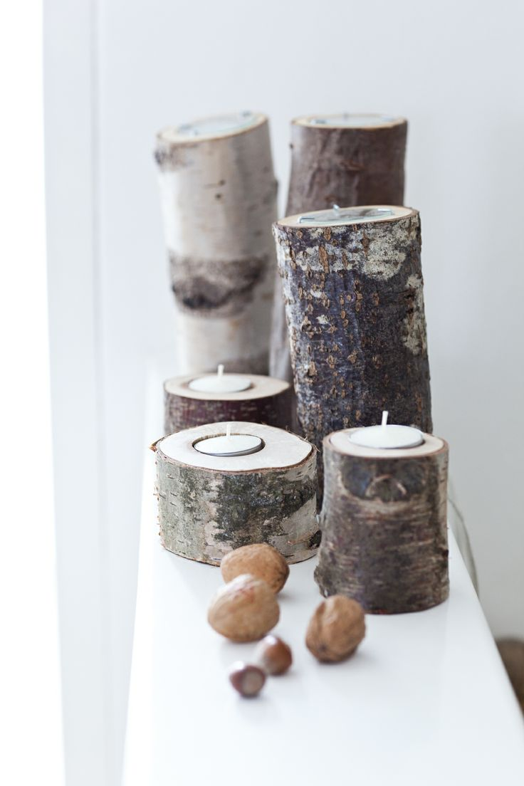 Candles made of little tree trunks. Photo: Bart Brussee for Green2 magazine.