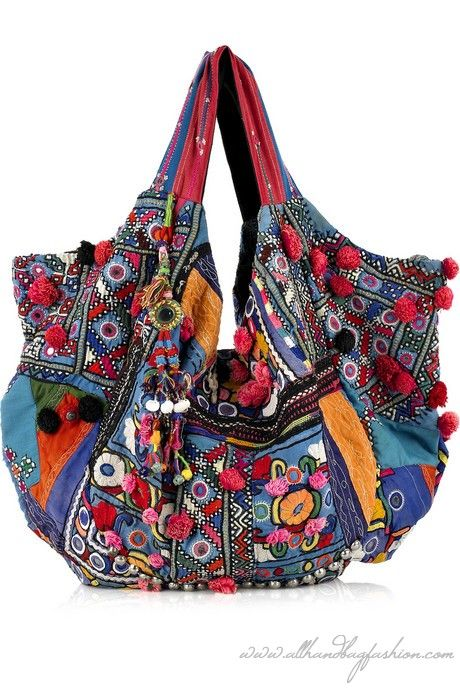 Simone Camille shoulder bag has two top handles, push-stud fastenings to expand, pompom and bead embellishment, two internal compartments, a zip-fastening pocket inside, coin, mirror and is lined in multicolored cotton. Designer color: Blue