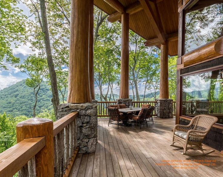 Covered porch on a log post and beam home I designed in North Carolina. Built by Nicola Logworks. For more photos or this or any other or my homes, please check out my website, www.designma.com #loghomes #loghomedesign #postandbeam