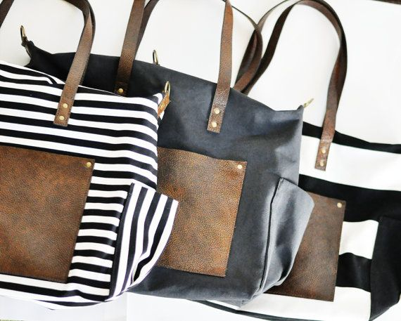 Etsy SeaportStitches - This functional and stylish diaper bag is perfect for any mom. It's made from heavyweight canvas material with leather straps and a leather front