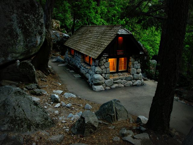 This is far too cute to have been converted into bathrooms! I am just going to pretend its just a cool cottage in the woods. :)  Stone cottage, Yosemite, via Flickr.