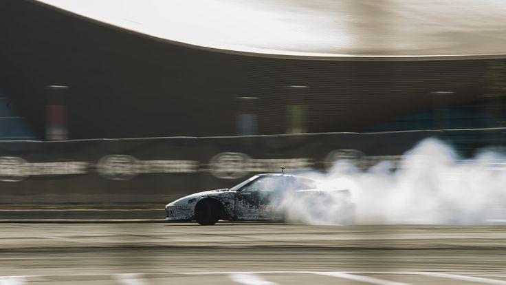 200sx flying through the smoke.