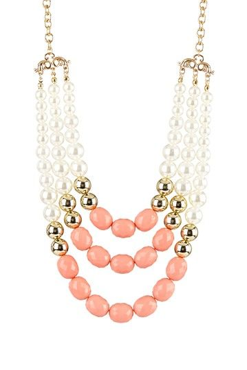 Bead layered bib necklace.