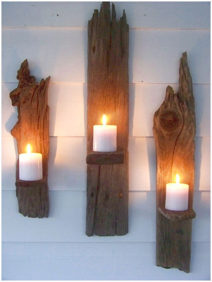 CELEBRATE EARTH WITH ECO FRIENDLY DÉCOR WITH THREE CANDLES WERE ATTACHED TO THE WALL