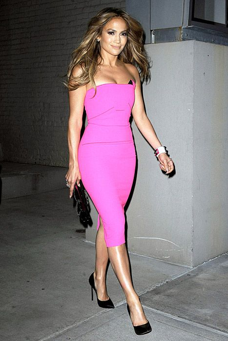 J.Lo is dropping a hot new album, so what's more fitting than a hot pink dress for the release parties? The look gets even sexier when paired with her perfect smoky eye.
