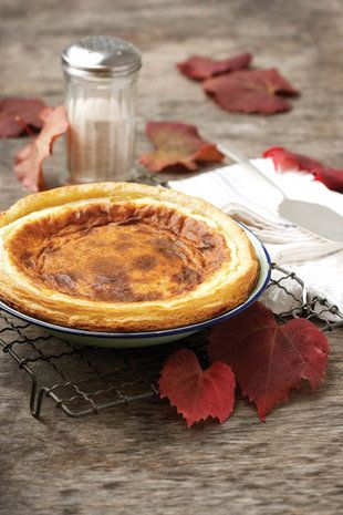 Milk tart (Melktert as it's called in Afrikaans) - traditionally with a puff pastry crust and a custard-like filling - a concoction of milk, eggs, sugar and cinnamon.  Delicious!!