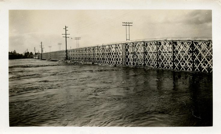 https://flic.kr/p/9aS3iY | West Maitland.  Belmore Bridge during the 1930 flood. | Looking towards Lorn. Photograph. Stamp on back - Jakeman, Chemist, W. Maitland.  This image was scanned from a photograph in the Newcastle and Hunter District Historical Society archives which are held by Cultural Collections at the University of Newcastle, Australia.  If you have any information about this photograph, please contact us.  Please contact us if you are the subject of the image, or know the…