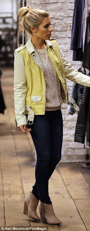 Oh it's a hard life: Rochelle's bandmate Mollie King also headed to the store in a lemon Harper leather jacket and jeans as she searched through the aisles