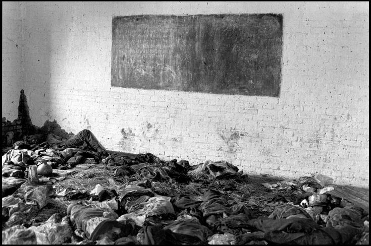 RWANDA. 1994. Tutsi corpses litter the floor of a classroom at a parish in Nyarubuye. More than 1000 people were killed here by civilian Hutu militia.