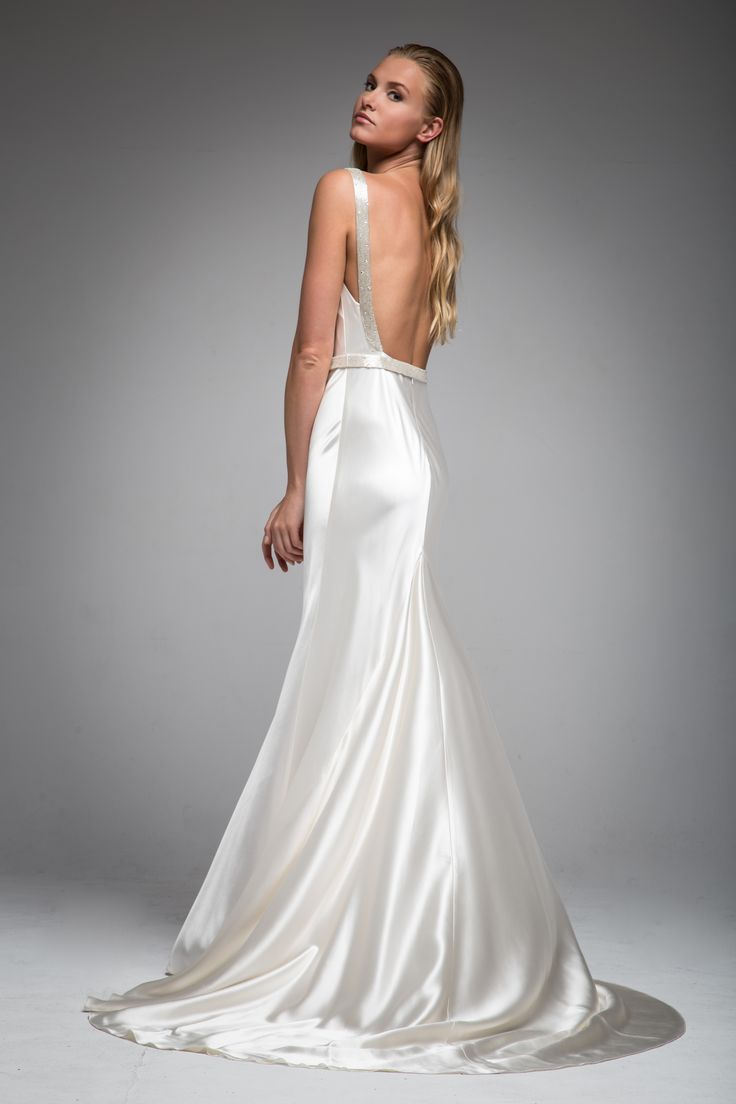 The Plunging Neckline On Jankssarah Hannah Wedding Dress Is Accompanied By An Equally Low Back