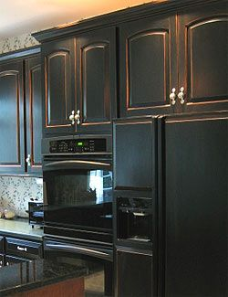 I updated my oak island cabinets to a distressed black and still love them – Yes, you can even hide that heavier oak grain, like mine – or use it over white cabinets, laminate, melamine…
