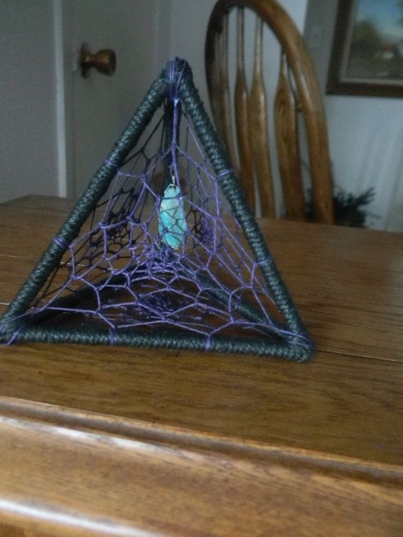 Check out this item in my Etsy shop https://www.etsy.com/listing/266874668/pyramid-dream-catcher-sculpture-standing