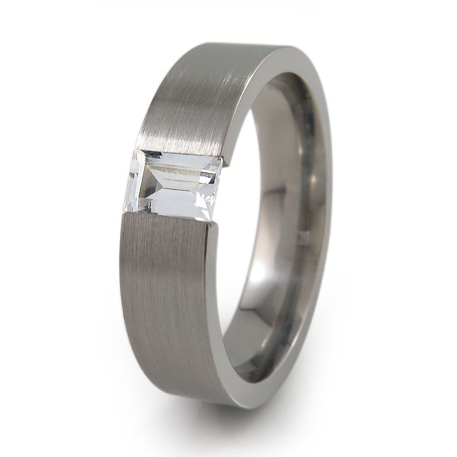 Simple yet unique ! Simple flat titanium ring with brushed finish, featuring a cushion cut gem, the ring has been custom crafted to create a continuous, flawless look with the tension-set gemstone.