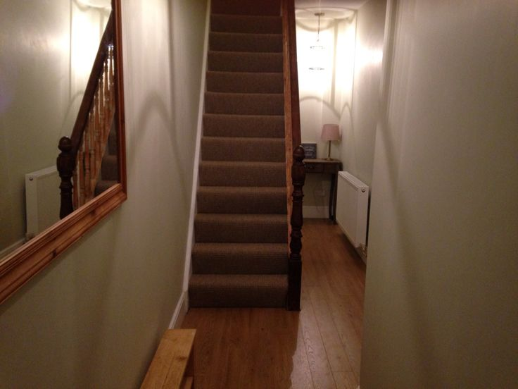 Jurassic stone dulux hallway with stripped banister