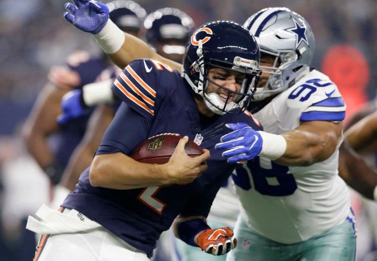 Chicago Bears quarterback Brian Hoyer is sacked by Dallas Cowboys defensive tackle Tyrone Crawford (98) in the first half of an NFL football game, Sunday, Sept. 25, 2016, in Arlington, Texas.