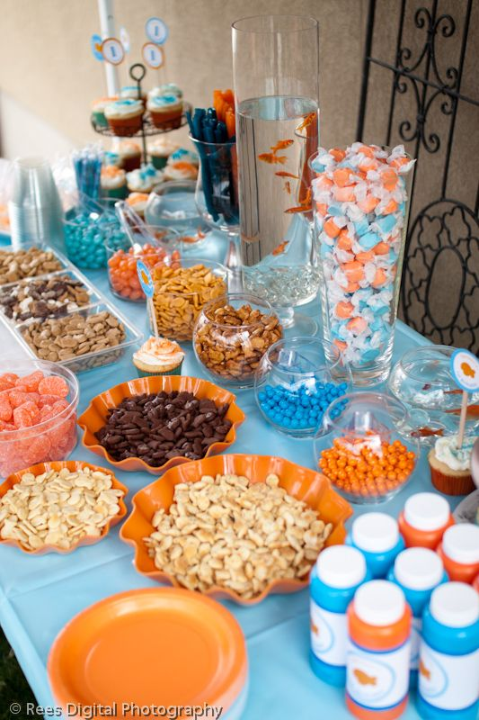 snack ideas:  blue and orange candy  goldfish crackers  cheese puffs  blue and orange bubbles  blue table cloth  orange plates   blue and orange cutlery