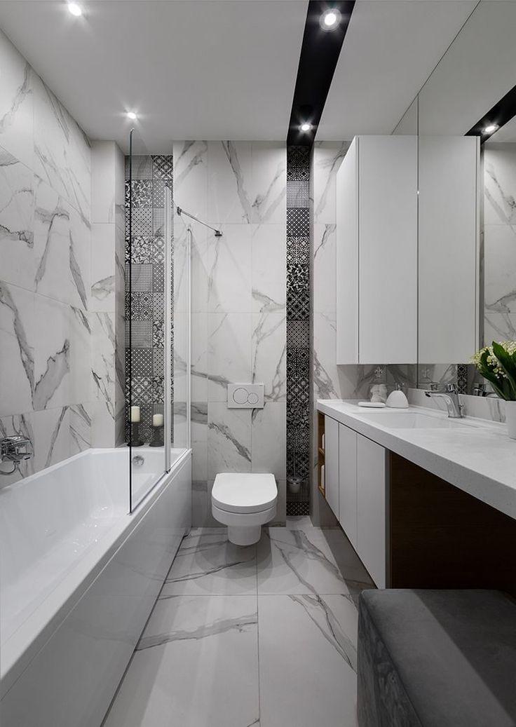 Kis lakás nagyon elegáns és modern, otthonos berendezéssel, mély zöldekkel, növény mintákkal, szép fa felületekkel - 35m2