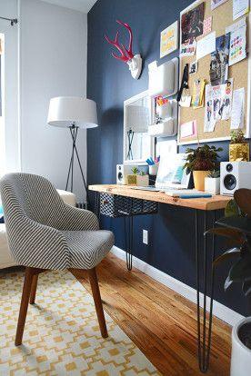 Moody walls and a modern desk in a Brooklyn home.