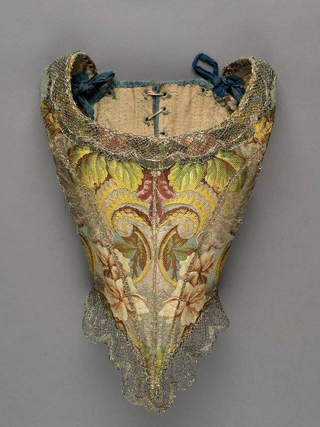 Cotilla o Corsé, 1735 (XVIII). Brocado de seda policromado y encaje (cierre trasero).