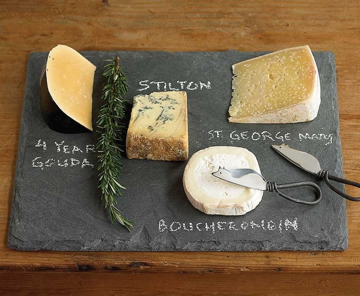 Our tapered-edge slate cheese board provides a natural, safe and secure cutting surface, perfect for writing cheese names with chalk, while its padded feet protect tabletops. Simply wipe clean with a damp cloth to maintain its natural appearance for years. Two knives included.