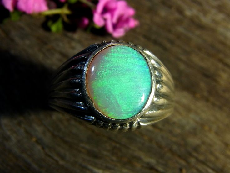 Just sold this 2,22 carat, 12 x 10 mm Solid Lightning Ridge Opal in a bezel Sterling Silver setting. For other items go to www.gemniopals.com.au and go to 'Online Store' ( via Etsy) All cut, polished and set in Maldon Victoria Australia.