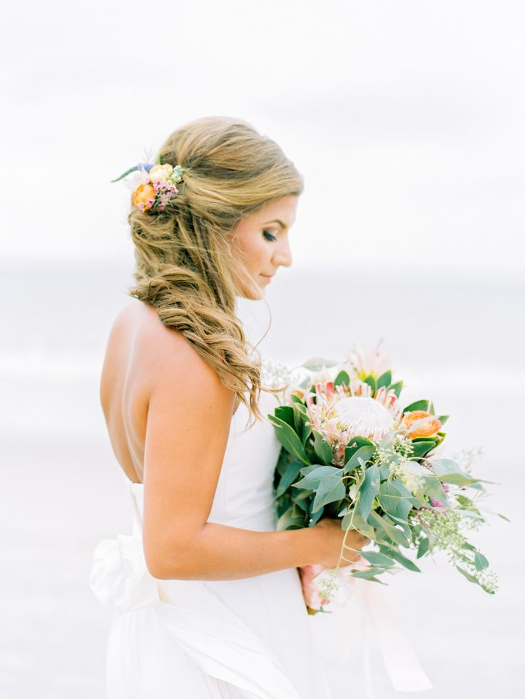 Beach wave wedding hairstyle: Floral Design: Blossom Bay Design - http://www.stylemepretty.com/portfolio/blossom-bay-design Photography: Love by Serena - lovebyserena.com   Read More on SMP: http://www.stylemepretty.com/2017/03/15/from-a-beach-proposal-to-a-bohemian-garden-seaside-wedding/