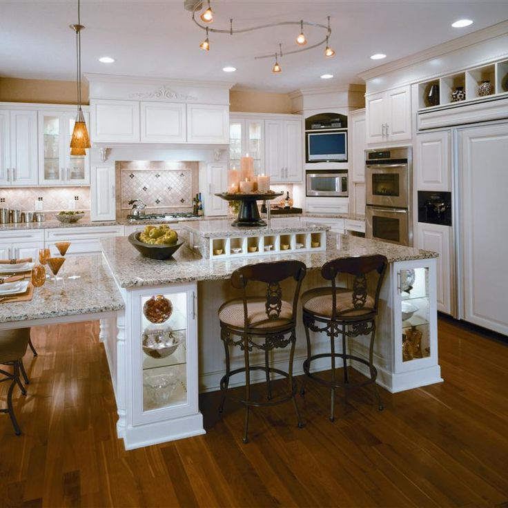 Brown Laminated Wooden Floor With White Laminated Wooden Kitchen Island  With White Countertop Cream Wall With Wall Cabinet And Silver Microwave  White ...