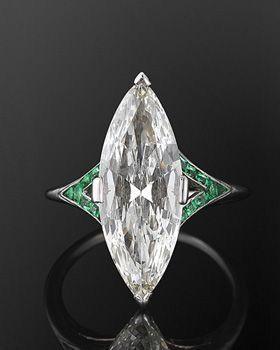 Art Deco Marquise Diamond & Emerald Ring http://www.allthingsvogue.com/best-affordable-silver-bangle-bracelets/