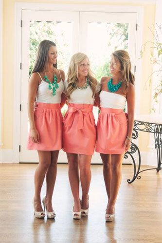 """short coral bridesmaid dress, i love the necklaces that add the splash of color. I think I would want my dresses to be a little more """"dressier"""" though."""