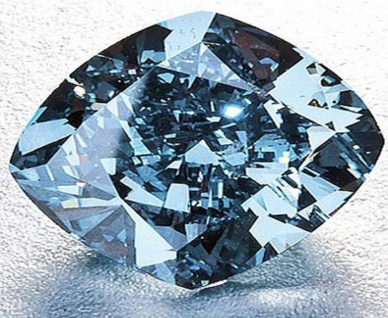 A flawless blue diamond weighing 7.03 carats was auctioned for 9.3 million USD