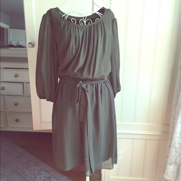 Olive green dress This is the prefect sexy dress for girls night or date night. Beautiful olive green in a flowy sheer material. There quarter length sheer sleeves, boat neck and belted waist. Falls above the knee. Size 14 petite. Purchased from one of my favorite poshers as a work dress but never wore, it's a little too sexy for work but perfect for a night out. En Focus Dresses