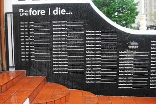 'Before I die wall' in Kloof Street. Go add your dream to the wall