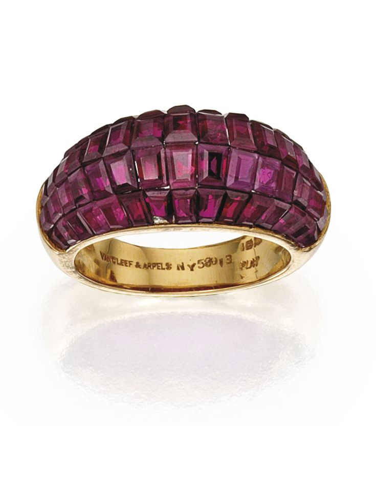 18 KARAT GOLD, PLATINUM AND MYSTERY-SET RUBY RING, VAN CLEEF & ARPELS. With 60 calibré-cut rubies, size 5, signed Van Cleef & Arpels, numbered NY 58013. With signed box.
