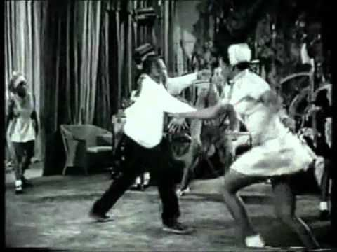 """Big Bad Voodoo Daddy - Go Daddy-O. (The dance routine was borrowed by an editor who put it with BBVD's music; it is the very same dance performance that appears in Universal's 1941 film """"Hellzapoppin.""""  Somebody has identified the dance troupe as, to quote the person, """"Whitey's Lindy Hoppers . . . . . If I remember right, Frankie Manning is the one in the overalls.""""  Well, the dance goes with the music here, all right. I have no problem with it.)"""