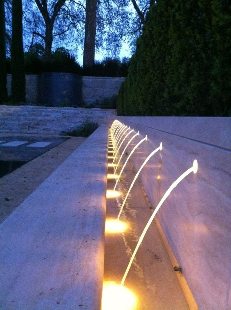 Stunning use of hidden led spotlights to create an effective glowing water feature find this pin and more on outdoor lighting