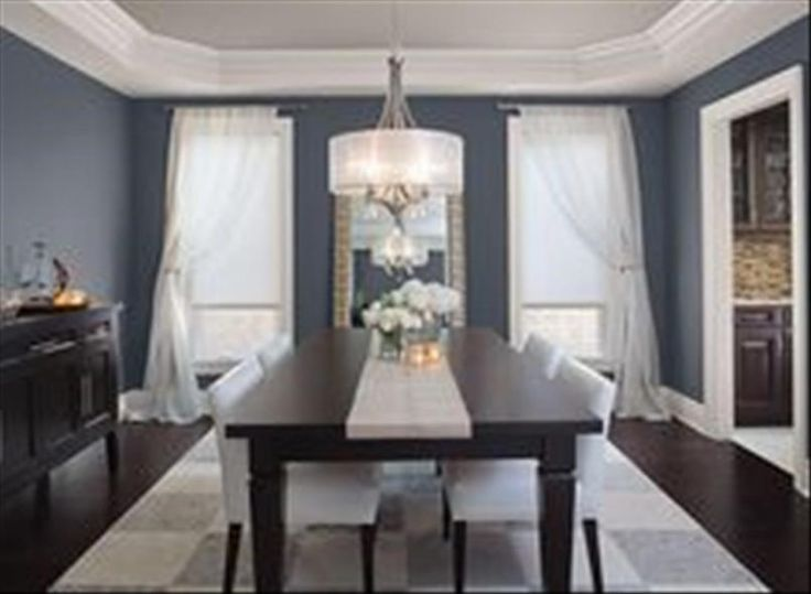 Dining Room Black Rectangle Dining Table With White Leather Dining Chair  Also Flower Vase And Table