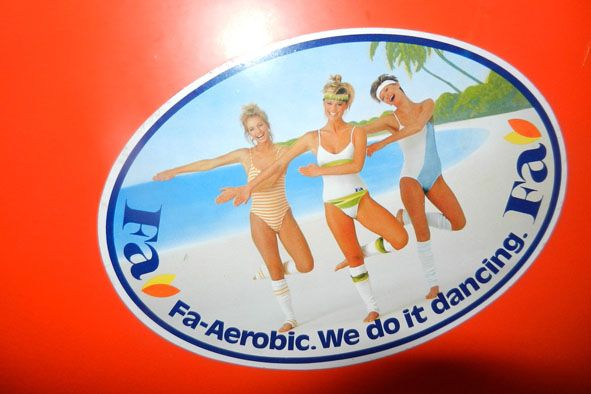Fa - Aerobic. We do it dancing.  Not sure what 'it' is. Vintage sticker