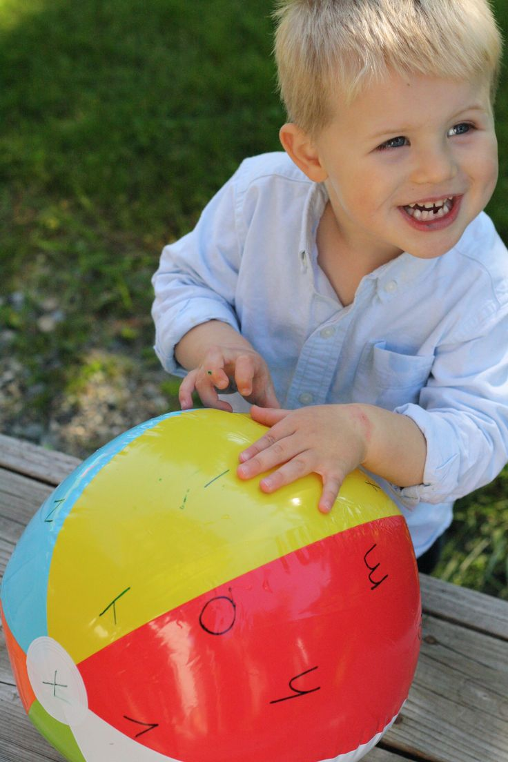 a beach ball labeled with letters tossed in the air makes a perfect alphabet learning game;  ask your child to throw the ball in the air, then catch it, naming the letters his hands touch