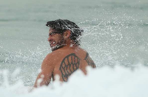 Jonathan Thurston wades in the ocean during an Australian Kangaroos training session at Coogee Oval on April 15, 2013 in Sydney, Australia. #Rugby #Sports