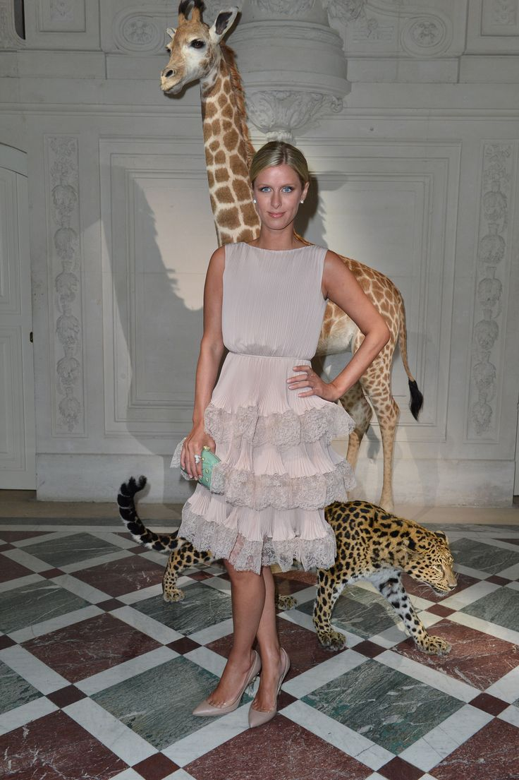 Nicky Hilton wears a Valentino dress from the Pre Fall 13/14 collection and Valentino Garavani shoes and clutch from the Spring Summer 2013 collection to the Valentino Fall/Winter 2013 Haute Couture show on July 3rd 2013 in Paris