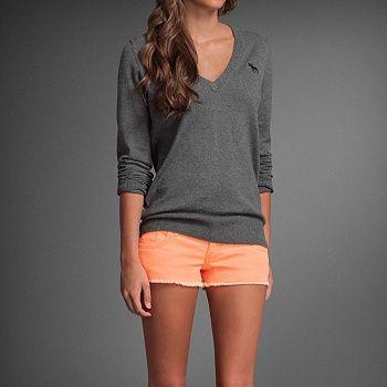 orange shorts, grey shirt